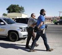Owner, armed men arrested after bar reopens despite Texas' order