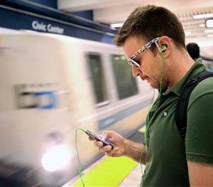 Nick Sabatasso checks his cell phone while waiting for a BART train at San Francisco's Civic Center station.