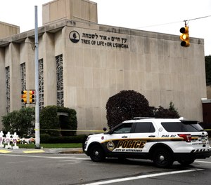A police vehicle is posted near the Tree of Life/Or L'Simcha Synagogue in Pittsburgh, Monday, Oct. 29, 2018. Tree of Life shooting suspect Robert Gregory Bowers is expected to appear in federal court Monday. Authorities say he expressed hatred toward Jews during the rampage Saturday morning and in later comments to police. (AP Photo/Matt Rourke)