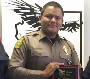 This undated photo provided by the Navajo Nation Office of the President and Vice President, shows Navajo Nation police officer James Largo. (Navajo Nation Office of the President and Vice President via AP)