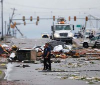 Rare August tornado sends 30 to hospital in Okla.