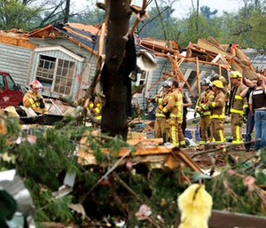 Firefighters work the site of the damage after a tornado ripped through Prairie Lake Estates trailer home park, just north of Chetek, Wis. (Dan Reiland/The Eau Claire Leader-Telegram via AP)