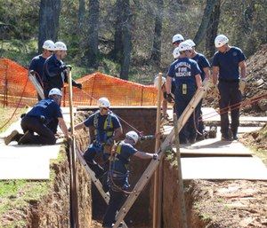 The Asheville Fire Department conducting trench training at Mountainside Park.