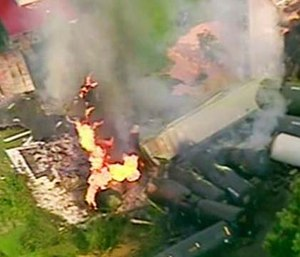A fire burns after dozens of cars of a freight train carrying hazardous materials derailed in Hyndman, Pa. (WPXI via AP)