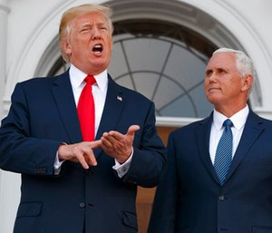President Donald Trump, accompanied by Vice President Mike Pence, speaks to reporters before a security briefing at Trump National Golf Club in Bedminster, N.J.