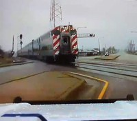 Video: Ill. LEO swerves off road to avoid being hit by train