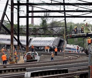 Federal investigators arrived Wednesday to determine why an Amtrak train jumped the tracks in Tuesday night's fatal accident. (AP Photo/Mel Evans)