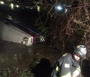 First responders work the scene after a car of a commuter train plunged into Alameda Creek after the train derailed Monday. (Aisha Knowles/Alameda County Fire Department via AP)