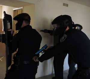 Sumter County police officers approach a simulated hostile during a police training exercise April 4, 2009.