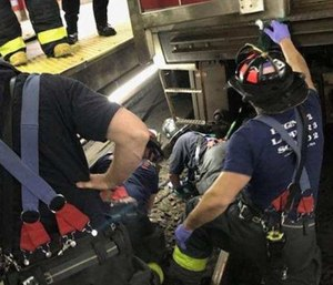 Awoman trapped between an MBTA train and the platform at Central Square station in Cambridge was rescued. (Photo/Cambridge Fire Dept.)