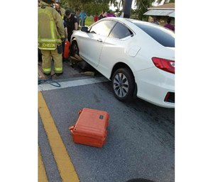 Crews work to extricate the trapped man. (Photo/ Fort Lauderdale Fire Rescue)
