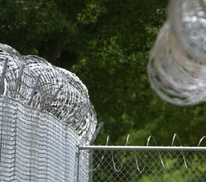 Barb wire fences surround the North Carolina Correctional Institution for Women.