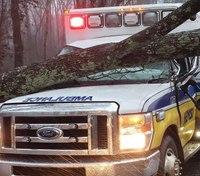 3 paramedics injured after ambulance struck by fallen tree