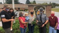 Trooper lauded for removing sisters from burning home