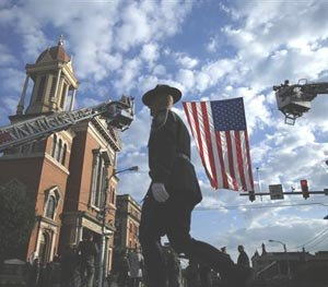 A law enforcement officer arrives for a funeral service for Pennsylvania State Trooper Cpl. Bryon Dickson, Thursday, Sept. 18, 2014, in Scranton, Pa.