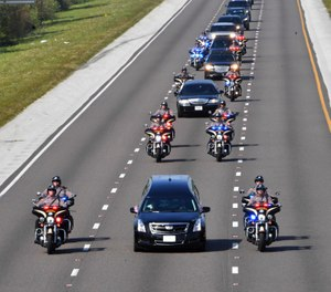 The funeral procession for Florida Highway Patrol Trooper Joseph Bullock proceeds on I-75 south-bound enroute to the Sarasota National Cemetery on Thursday, Feb. 13. (Photo/AP)