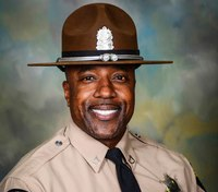Woman kills retired trooper, wounds 2 other troopers at cigar bar