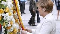 Police present flag to German Chancellor at 9/11 memorial