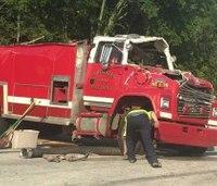 Firefighter injured after tanker tips
