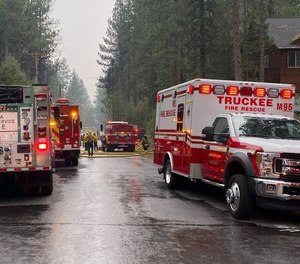 Crews work at the scene of a plane crash in Truckee, California.