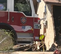 Runaway fire truck crashes into house