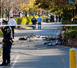 Bicycles and debris lay on a bike path after a motorist drove onto the path near the World Trade Center memorial, striking and killing several people Tuesday, Oct. 31, 2017, in New York. (AP Photo/Craig Ruttle)