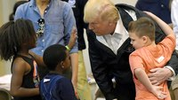 Upbeat Trump pitches in at shelter for Harvey victims