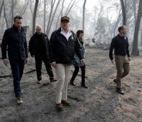 President Trump visits fire-ravaged Calif.