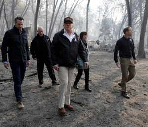 A somber President Trump toured the devastation of California's deadly wildfires Saturday. (Photo/AP)