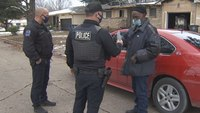 Okla. cops surprise man who lost possessions in house fire