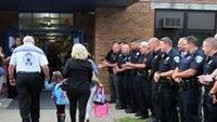 Daughter of slain Ohio officer gets police escort to kindergarten