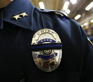 Brain McPike, chief of the University of Colorado-Colorado Springs police force, attends a vigil held on University of Colorado-Colorado Springs' campus Saturday, Nov. 28, 2015. (AP Image)