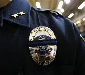 Brain McPike, chief of the University of Colorado-Colorado Springs police force, attends a vigil held on University of Colorado-Colorado Springs' campus Saturday, Nov. 28, 2015.