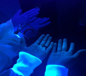 An Florida Atlantic University emergency medicine physician and collaborators discovered the presence of fluorescent solution on health care workers' skin after a simulation training exercise, which represented exposure to a contagion and indicated they made an error while putting on or taking off their PPE. (Photo/Rami A. Ahmed, D.O., Indiana University School of Medicine)