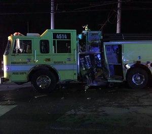 A Uniontown firefighter and a motorist were injured after a car struck and damaged a fire engine.