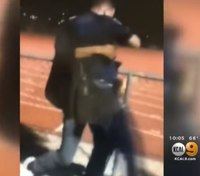 Video: Teen bodyslams Calif. SRO at high school football game