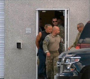 This frame grab from video provided by WPLG-TV shows FBI agents escorting Cesar Sayoc, in sleeveless shirt, in Miramar, Fla., on Friday, Oct. 26, 2018.  (WPLG-TV via AP)
