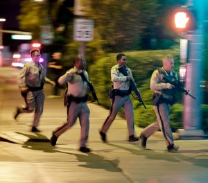 Vegas police during the biggest mass shooting in modern day history (Photo/ Associated Press)