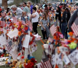 People visit a makeshift memorial honoring the victims of the Oct. 1 mass shooting, Sunday, Nov. 12, 2017, in Las Vegas. (AP Photo/John Locher)