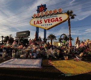 People visit a makeshift memorial for victims of the mass shooting in Las Vegas, Monday, Oct. 16, 2017, in Las Vegas.