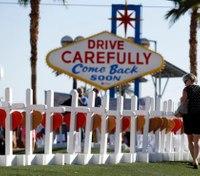 Thousands mourn slain officer as Las Vegas probe goes on