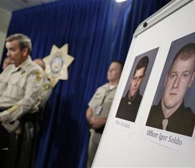 Sheriff Doug Gillespie, left, speaks at a news conference on the shooting of two Las Vegas Metropolitan Police Department officers Sunday, June 8, 2014 in Las Vegas. (AP Image)