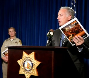 Clark County Sheriff Joe Lombardo announces the release of the Oct. 1, 2017, shooting After-Action Review with report authors Detective Stephanie Ward, left, and Capt. Kelly McMahill during a news conference at Metropolitan Police Department headquarters Las Vegas Wednesday, July 10, 2019. (K.M. Cannon/Las Vegas Review-Journal via AP)
