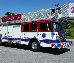 The aerial truck is a 2016 E-One Cyclone II Extreme Duty cab and chassis with a 95-foot rear mount tower ladder.