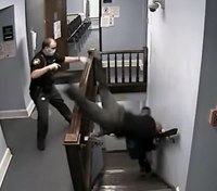 Video review: Officer dives down courthouse stairs to prevent suspect's escape