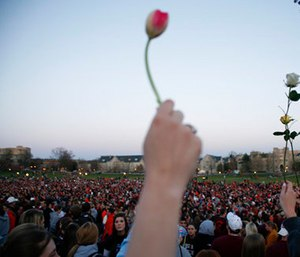 People gather for a vigil on the drill field following the shootings on the Virginia Tech campus in Blacksburg, Va. (AP Photo/Casey Templeton, File)