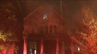 Mass. officer 'kicks down door' to save residents from house fire