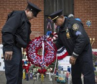 Thousands attend wake for slain NYC officer