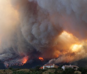 Fire from the Waldo Canyon wildfire burns as it moved into subdivisions and destroyed homes in Colorado Springs, Colo. (AP Photo/Gaylon Wampler)