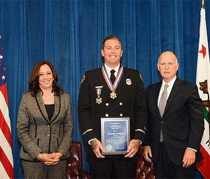 Governor Brown and Attorney General Harris with San Diego Fire-Rescue Department Firefighter Alexander Wallbret. (Photo/California Governor's Office)